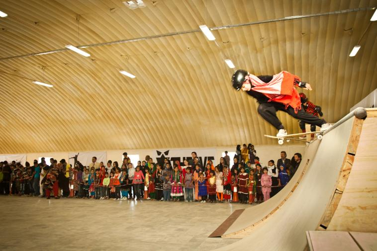 Girl skateboarding at event at Skateistan Kabul